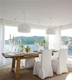 white dining room overlooking the ocean