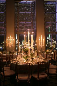 """""""The mirrored tabletops and crystal chandeliers fit in with the Art Deco style of the space, and the small arrangements of wildflowers, greens, and berries lent a more lush and poetic feel to the environment."""" Joseph Altuzarra and Seth Weissman's Wedding"""