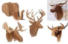 cabezas de animales hechas de cartón reciclado