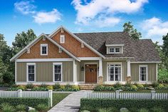 This charming craftsman cottage features 3 bedrooms and open-concept living. A large great room with trayed ceiling is open to the well-equipped kitchen which includes a large island and eating bar. Craftsman Cottage, Craftsman Style House Plans, Ranch House Plans, Cottage House Plans, Small House Plans, Cottage Homes, Craftsman Exterior, Cheap House Plans, Cottage Exterior