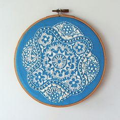 love the white on blue embroidery!