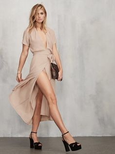 Looking just straight up pretty is what a girl needs sometimes. The Hadley Dress is a sheer ghost crepe midi dress with a plunging neckline, short sleeves and (adjustable) wrap skirt that ties at the waist. The top is loose and relaxed, fitted through the waist. Made from 57% viscose, 43% rayon.