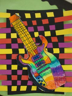 Analogous colored guitars on paper weavings. I brought in my bass for the students to draw from and we used oil pastels to blend analogous colors. It helped for the kids to have a color wheel for reference