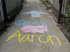 Chalk on the driveway points to backyard (and helps people see which house to go to!