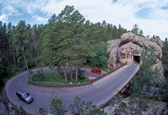 """Iron Mountain Road, Black HIlls SD is a work of art in itself. The hwy connects Custer State Park & Mount Rushmore. It includes 3 tunnels that frame Mount Rushmore in the distance. It is also famous for """"Pigtail Bridges"""" It was constructed in the South Dakota Vacation, South Dakota Travel, Custer State Park, The Places Youll Go, Places To See, The Ranch, State Parks, Places To Travel, Architecture"""