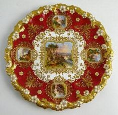 A Coalport cabinet plate, painted with various rural views within a finely gilt cartouche and richly jewelled, against a claret and embossed ground