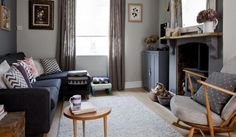 Toning grey walls teamed with upcycled furniture and vintage finds give this living room a cosy feel.