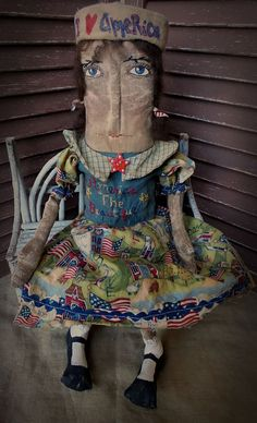 """Primitive Doll, Extreme Primitive, Very Primitive, Americana, Patriotic, Home of the Brave, Cloth Doll, Hafair, TeamHaHa, Star, Stripes, Blue, green, Doll by Mustard Seed Originals on Etsy.com.  20"""" tall Sunshine is the perfect doll to add to your patriotic collection. She wears a dress with a blue bodice that I hand embroidered """"America the Beautiful"""" with stars in red, white, blue and gold. The fabric I used for the sleeves and skirt is a very unique American scened of rolling hills, sea…"""
