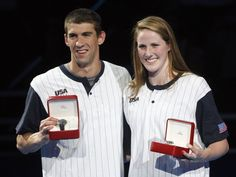 Michael Phelps (L) and Missy Franklin (R) pose with watches given to them as the best performers at the U.S. Olympic swimming trials, in Omaha, Nebraska, July 2, 2012. REUTERS/Jeff Haynes (UNITED STATES - Tags: SPORT SWIMMING OLYMPICS)