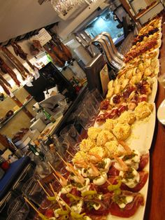 Pintxos heaven in San Sebastian Antipasto, Restaurant Patio, Tapas Recipes, Tapas Bar, Tasty, Yummy Food, Food And Drink, Appetizers, Heaven