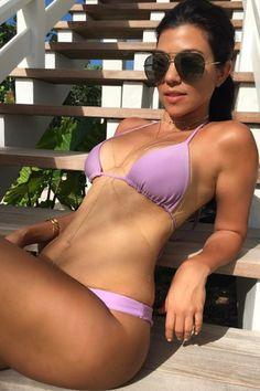 Kourtney Kardashian Keeps It 100 With Her Swimsuit Game