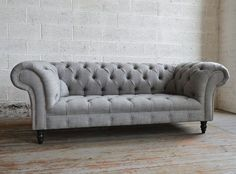 The Romford Wool Chesterfield Sofa is based on a classic Chesterfield Sofa design. However with it's oversized features which include it's extra large studs, accentuated elegant swopping arms and deep back, this sofa is perfect for those seeking contemporary living with a bold furniture centre piece. - British handmade in our Manchester Factory - Premium sourced wool - Solid beech frame - Deep buttoned - Timeless design - 10 year guarantee - Free delivery