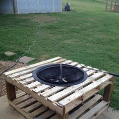 "We did a twist to an idea we saw on Pinterest. This is our firepit table. Made from 2 pallets and 4 12"" 4x4 post. Use a nail and string to mark your firepit hole. We used a jig saw to cut it out and used inner slats to reprace aroud fire pit. Drop the pit in and enjoy. :)"