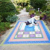 Faux painting rug on concrete patio - This is really cool.