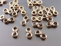 4 tiny rose gold simple infinity charms with CZ Cubic by EverLuxe