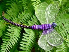 DIY: How to make a beaded punched tin dragonfly ornament. Also includes a link for a kid friendly version using metallic card stock scrap book paper.