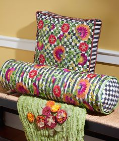 These colorful embroidered Dahlia Pillows are inspired by our gardens in Aurora, New York. They make a bold statement mixed with our stripes and checks!
