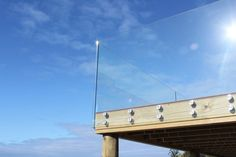 We offer modern, stylish glass options for a variety of outdoor spaces. Choose your glass balustrades, frameless or semi-frameless and enhance your home! Glass Balcony Railing, Balcony Deck, Outdoor Balcony, Frameless Glass Balustrade, Door And Window Design, Stair Railing Design, Seaside Garden, Glass Fence, Glass