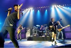 The drummer of hard rock group AC/DC, Phil Rudd, appears in a New Zealand court on charges of attempting to arrange a murder. Bon Scott, Brian Johnson, Hard Rock, Angus Young, Malcolm Young, Neil Young, Ac Dc Members, Ac Dc Guitarist, Acdc Albums