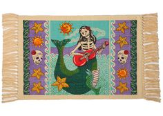 "Day of the Dead Cotton Stencil Collection   Our Day of the Dead Cotton Stencil Collection incorporates unique and lively Mexican Folklore Designs with bright festive colors to add a  one-of-a-kind look to your home  Cotton Stencil Placemats SOLD IN SETS OF 6  APX. 13"" X 19""   Stenciled on 100% Cotton  Imported"