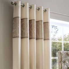 Featuring a jacquard panel pattern in a natural shade, these eyelet curtains contain a thermal lining to block out draughts, noise and sunlight, and are availab...