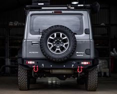 Wildog Accessories manufactures this all-in-one rear replacement bumper. It provides a snug fit for maximum ground clearance and departure angles. New Suzuki Jimny, Jimny 4x4, Samurai, Jimny Sierra, Jeep Mods, Mitsubishi Pajero, Off Road, Jeep Wrangler, Dream Cars