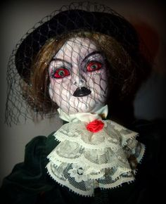 woman in blacknow this is a scary doll