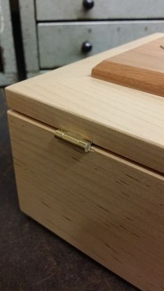 Here's a sample box we had made by a local woodworker to show off our JB-250 lid supports as well as our CB-301 butt hinge.  www.brusso.com