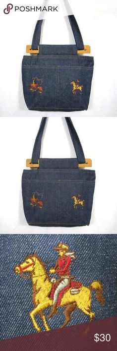 Western Purse Denim Embroidered Horses Cowboy Blue Western Style Embroidered Purse  Blue denim with embroidered cowboy theme and batik floral pattern lining  Measures approximately 14 x 11 x 4 1/2 inches  Strap drop is 13 inches, wood top closures pull together with the strap, no fastening   Three outside pockets, 6 inside pockets surround middle section  Great condition! unbranded Bags Shoulder Bags