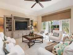 1891 Kingfish Rd, Naples, FL 34102 | Pretty coastal family room - neutral with a pop of color and texture.  Royal Harbor