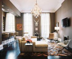 Greige walls, chandelier, patterned rugs - great living room.