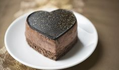 A luxurious chocolate mousse cake decorated with gold dust on a gold. Heart Shaped Chocolate, Chocolate Mousse Cake, Cupcakes, Cake Decorating Techniques, How Sweet Eats, Plan Your Wedding, Biscotti, Heart Shapes, Deserts