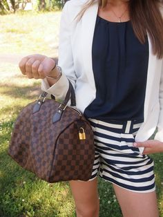 Summer outfit with striped shorts and white blazer.
