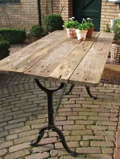 "DIY: awesome pallet tabletop. And what a great iron stand! Hey, what about those two cast iron mystery ""stands"" that I found buried in the old garage? Would be coffee table size. Think about it!"