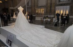 An Italian flourish: The wedding dress of Princess Madeleine of Sweden, designed by Valentino Garavani, is seen on display during an exhibition at the Royal Palace