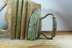 vintage patina sad ironbook end by vintagearcheology on Etsy, $32.00