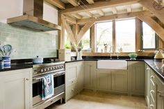 Painted shaker kitchen in oak framed house in Cornwall