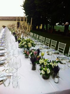 Our Venue Shannon! Arrangments at the table: flowers and chandeliers Castello di Meleto