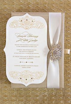 Like parts of this for my DIY wedding invites! Like the shape of the white piece and the ribbon. Both easy to do on your own as well! :)