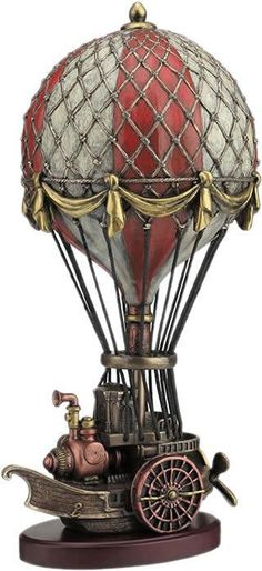 A key aspect of the Steampunk lifestyle is travel, especially via turn-of-the-century vessels such as boats, propeller planes, and hot air balloons. Journey to fantastical lands in your decor with the Steampunk Hot Air Balloon Statue. Design Steampunk, Steampunk Kunst, Steampunk Home Decor, Steampunk Airship, Style Steampunk, Steampunk House, Steampunk Diy, Steampunk Fashion, Steampunk Cosplay
