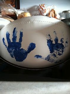 Father's Day gift?!? This is the plan, but the baseball looks like it might turn out cuter...but using the football allows for me to put both boys' handprints on it.