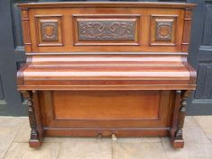 UPRIGHT PIANO. 7 OCTAVE. IRON FRAME OVERSTRUNG AND UNDERDAMPED Lissack & Co