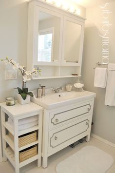 Storage up behind and below mirrors! Storage down/beside: Suburbs Mama: Master Bathroom Reveal IKEA vanity