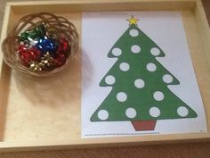 "Fine-motor Christmas fun - placing bows onto the tree ("",)"