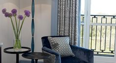 Detail of a room at The Bekerley Hotel London. Armchair with two different pattern.
