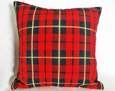 Red Wool Plaid Pillow Decorative Christmas by PillowThrowDecor.  These would be cute against our black leather couches, but I'm not sure how the bright red would look with our maroon/navy/forest green color scheme.  They would also be cute on a screen porch.