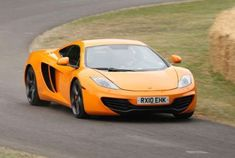 McLaren created the MP4-12C not to outdo its legendary F1 model of the '90s, but instead to take on ... - Provided by Popular Mechanics