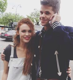 Max Carver on the phone with a french fan, in Paris with Holland Roden (07/07/14).