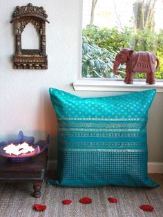 Jeweled Peacock ~Turquoise Blue and Gold Sari EURO SHAM (Complementary): Our decorative Euro Pillow shams are the key accessory to a fully dressed bed. Accessorize lavishly and complete the look of your exotic handcrafted bedding ensemble by picking European pillow shams that either match or complement your choice of duvet cover or bedspread.