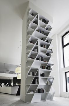 A play on words at a time when an increasing number of books are read online, the Web bookcase for Poliform reconsiders the book as object. Composed of alternating blocks and voids, the Web's slanted and skewed shelves function as display cases for objects as well as books. The all white bookcase is made from highly durable Dupont Corain.